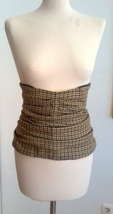 Waist cincher showing recycling from a pair of mens trousers